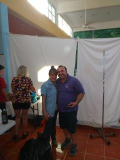 Carlos Loriaborges (right), tireless Administrator of PPI's clinic in Puerto Morelis (with a volunteer)